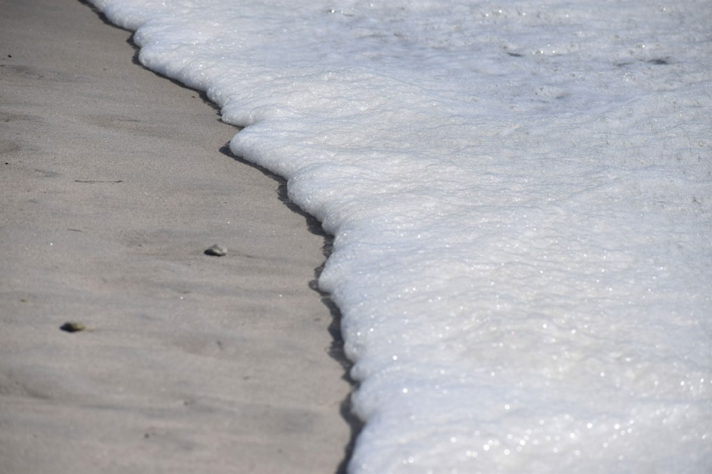 Image of close-up beach bubbles