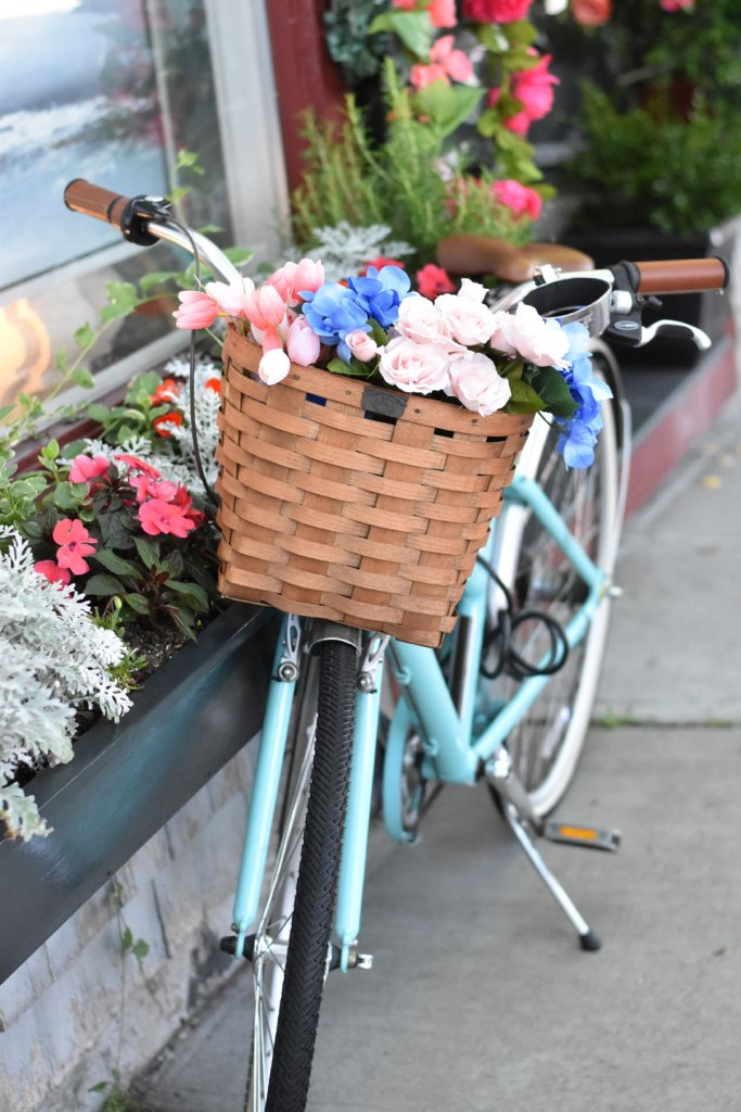 Image of Blue Bike with Flower Basket